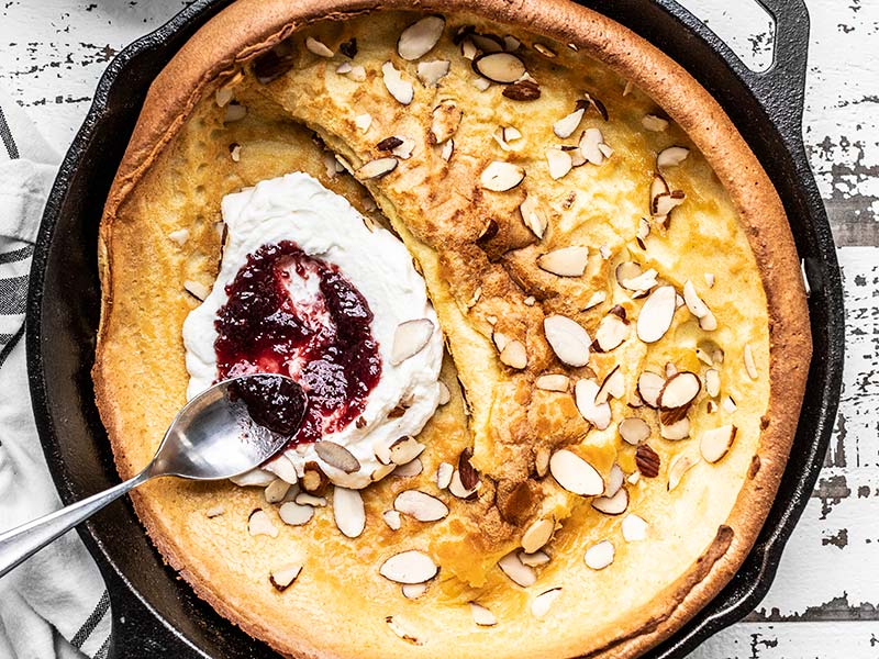 Almond Dutch Baby with Ricotta and Jam